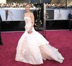 Jennifer Lawrence wore a Dior Haute Couture white-and-pale pink strapless gown with fitted bustier and poufy hemline. (From The Associated Press)
