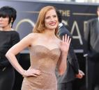 Jessica Chastain turned heads at the Oscar ceremony in a glistening copper-tone, strapless Armani gown with mermaid hem, which created the look of  an old-world glamorous movie star. (From The Associated Press)