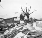 Amid the ruins: An unidentified woman stands amid the wreckage of a home in LaGrange County. The home was gone and only the furniture remained. The scene was re-enacted scores of times throughout La Grange County and other hard-hit areas in the paths of tornadoes April 11, Palm Sunday, 1965. LaGrange County recorded about 20 dead and scores injured in the storm.