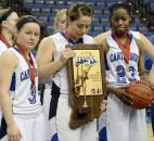 The Canterbury team captains, Darby Maggard, Emma Hyndman and Kindell Fincher received the runner-up game ball and trophy at the end of the game, Canterbury fell to Heritage Christian 61-64 in Terre Haute Saturday during the Class 2A IHSSA Girls Basketball State Final.