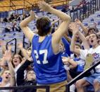 The Canterbury High School student section tries to raise some team spirit during the third period of the game Saturday. Canterbury High School fell to Heritage Christian 61-64 in Terre Haute during the Class 2A IHSSA Girls Basketball State Final.