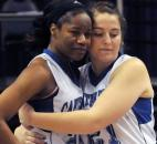 Canterbury's Kindell Fincher gets a hug from teammate Emma Hyndman at the end of the game with Heritage Christian. Canterbury fell to Heritage Christian 61-64 in Terre Haute Saturday during the Class 2A IHSSA Girls Basketball State Final.
