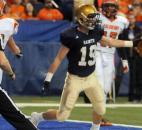 Bishop Dwenger's Gus Schrader scores a touchdown in the third quarter.