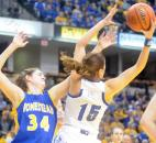 Homestead's Grace German has the ball stolen by Columbus North's Elle Williams during the second quarter of the game Saturday night during the 4A girls final game.