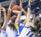 Madisen Parker is sandwiched by players from Columbus North during the fourth quarter Saturday night during the IHSAA 4A final game.
