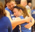 At the end of the game Canterbury's Darby Maggard gets a hug from her teammate Katherine Smith. Canterbury lost to Heritage Christian in the class 2A IHSAA Girls Basketball finals Saturday. The final score was 73-53.