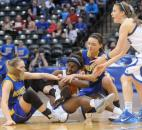 Homestead players, Karussa McLaughlin left and Lindley Kistler, right, tussle with Debie Gedeon, late in the fourth quarter of play Saturday night during the the Class 4A final in Indianapolis. Homestead fell to Columbus North, 56-62.