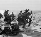 "In this April 10, 1965, file photo, made by Associated Press correspondent Peter Arnett, newly-landed U.S. Marines make their way through the sands of Red Beach at Da Nang, Vietnam on their way to reinforce the air base as South Vietnamese Rangers battled guerrillas about three miles south of the beach. More than two bitter decades of war in Vietnam ended with the last days of April 1975. Today, 40 years later, Arnett has written a new memoir, ""Saigon Has Fallen,"" detailing his experience coveri"