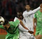 Algeria's Foued Kadir, left, and United States' DaMarcus Beasley, right, compete for the ball during the World Cup group C soccer match between the United States and Algeria at the Loftus Versfeld Stadium in Pretoria, South Africa, Wednesday, June 23, 2010.