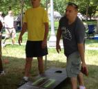 Troy and Steve Panning throw cornhole bags in Fort Wayne Newspaper's Cornhole Classic at the Three Rivers Festival. (Photo by Jaclyn Goldsborough)