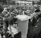 In this April 29, 1975 file photo, South Vietnamese civilians scale the 14-foot wall of the U.S. embassy in Saigon, trying to reach evacuation helicopters as the last Americans depart from Vietnam. (AP Photo/File)
