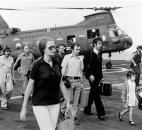 In this Tuesday, April 29, 1975 file photo, American citizens arrive aboard the command and control ship USS Blue Ridge after being evacuated out of Saigon, South Vietnam, by U.S. Marine and Air Force helicopters operating from Navy ships. (U.S. Navy via AP, File)