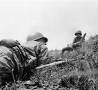 In this April 5, 1965 file photo, Capt. Donald R. Brown crouches on the ground in Saigon, waiting for the order for attack across an open field against Vietcong positions in a treeline from where enemy combatants with automatic weapons had briefly pinned down the HQ company of the 2nd Battalion, 46 Regiment. (AP Photo/File)