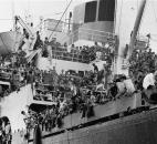 In this April 23, 1975 photo provided by the Department of Defense, Vietnamese refugees crowd aboard the Military Sealift Command ship Pioneer Contender to be evacuated to areas further south. (Department of Defense via AP, File)