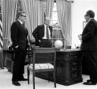 In this April 28, 1975 photo provided the White House via the Gerald R. Ford Library, President Gerald Ford, center, meets with Secretary of State Henry Kissinger, right, and Vice President Nelson Rockefeller in the Oval Office of the White House to discuss the American evacuation of Saigon. (David Hume Kennerly/White House, Gerald R. Ford Library via AP, File)