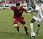 Czech Republic's Ondrej Kusnir (2) tries to hold off United States' DaMarcus Beasley, right, from controlling the ball during the first half of a friendly soccer match in East Hartford, Conn., Tuesday, May 25, 2010. The Czech Republic won 4-2.