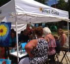 A group of people participate in a free Wine & Canvas session as part of the Art in the Park at the Three Rivers Festival in downtown Fort Wayne. (Photo by Jaclyn Goldsborough)