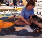 Madison Aschliman, an artist at the Fort Wayne Museum of Art's Chalk Walk at the Fort Wayne Newspapers Three Rivers Festival and junior at Snider High School, created her sidewalk art freehand, without a previous sketch. (Photo by Jaclyn Goldsborough of The News-Sentinel)
