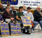 Attendees of Tuesday night's rally against right-to-work legislation listen to remarks by Angola Mayor Richard Hickman. More than 100 people attended the rally in Fort Wayne. Photo by Sarah Janssen