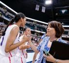 Indiana All-Star Ariana Simmons of South Side High School slaps hands with Archers head coach and Indiana All-Star assistant coach Juanita Goodwell after their team's victory over Kentucky on Saturday at Bankers Life Fieldhouse in Indianapolis. (Photo by Gannon Burgett for The News-Sentinel)