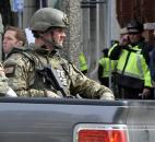 Armed Massachusetts State Police roll into the area after an explosion at the 2013 Boston Marathon on Monday in Boston. Photo by By The Associated Press