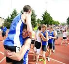 Carroll athletes, Jonathan Harper, Eric Claxton, Kyle Gater and Alexander Hess celebrate winning first place the boys 4x800-meter relay. (Photo by Gannon Burgett for The News-Sentinel)