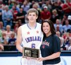 Indiana All-Star Collin Hartman poses with his mother after receiving the Citizenship Award in the series against Kentucky on Saturday at Bankers Life Fieldhouse in Indianapolis. (Photo by Gannon Burgett for The News-Sentinel)