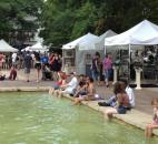 People try to keep cool amid the humid weather Sunday afternoon at Art in the Park in Freimann Square. (Photo taken 7-14-13)