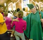 Bishop John D'Arcy, right, greets one of the migrant families at the conclusion of a Mass in September 2009 at St. Joseph Catholic Church in Bluffton. News-Sentinel file photo
