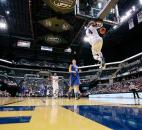 Indiana All-Star Devin Davis of Warren Central High School dunks against Kentucky on Saturday at Bankers Life Fieldhouse in Indianapolis. (Photo by Gannon Burgett for The News-Sentinel)