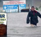 After checking to make sure his boat line is secure, Bob Casseday crosses the flooded street just over the bridge along Savannah Road in Lewes, Del., to get back home Monday as Hurricane Sandy hits Delaware.
