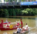 """The Viking"" boat slows down after being cheered on during the Three Rivers Festival ""River Games"" in July. This was the second year for the ""River Games,"" which returned activities to the water. Photo by Hana Hawash"