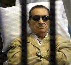 Egypt's ex-President Hosni Mubarak lays on a gurney inside a barred cage at the police academy courthouse in Cairo, Egypt. Mubarak was sentenced in June to life in prison for his role in the killing of protesters during last year's revolution that forced him from power after nearly three decades. Photo by The Associated Press