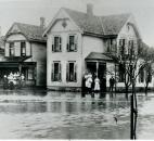 Residents watched the high water rise at their home at Marion and Second streets. (News-Sentinel file photo)
