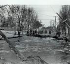 Water poured over the banks of the St. Joseph River along St. Joe Boulevard. The Tennessee Avenue Bridge is in the background. (News-Sentinel file photo)