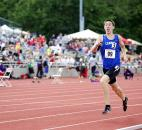 Jonathan Harper of Carroll starts to show excitement as he closes in on the last 50 meters of the 4x800-meter relay. Carroll won with a time of 7:40.14. (Photo by Gannon Burgett for The News-Sentinel)