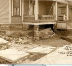 Damaged foundations and sidewalks were commonplace after the flood. (Photo courtesy of the Harter Postcard Collection/ACPL)