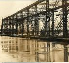 Rising water from the St. Marys River threatened to submerge the roadbed of the Main Street Bridge (Photo courtesy of the Harter Postcard Collection/ACPL)