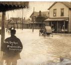 An unidentified man watched wagons navigate the floodwaters at the corner of Spy Run Avenue and Wagner Street. (Photo courtesy of the Harter Postcard Collection/ACPL)