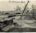 After the floodwaters receded, extensive damage to the pavement and the riverbank at the Tennessee Avenue Bridge was revealed. (Photo courtesy of the Harter Postcard Collection/ACPL)