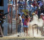 Inmates relatives clash with police outside a prison after a deadly fire in Comayagua, Honduras. More than 350 inmates perished in the February fire that swept through the prison. More than half the inmates were still awaiting trial.  Many of those who died had been locked up for petty crimes: stealing a wallet, robbing a truck. Some had never been charged. Photo by The Associated Press