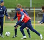 Midfielder Damarcus Beasley, center, of Chicago Fire, practices with the US national soccer team during a practice session in Warsaw, Monday March 29, 2004, two days before they meet Poland in an international friendly soccer match.