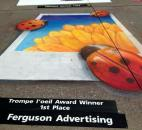An almost 3-D effect earned Ferguson Advertising an award in the weekend Chalk Walk contest on Main Street during the Fort Wayne Newspapers Three Rivers Festival. (Photo taken 7-14-13)