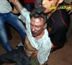 In this image from video, the body of U.S. Ambassador Chris Stevens is moved by Libyan civilians trying to rescue him after gunmen and protesters rampaged through the U.S. consulate in Benghazi, Libya, on Sept. 11. Three other Americans were also killed in the attacks, which sparked controversy and a congressional investigation. Photo by The Associated Press