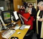 Bishop John D'Arcy blesses the broadcast studio for Redeemer Radio, the new Catholic Radio station, in January 2006. News-Sentinel file photo