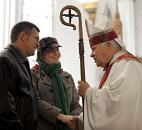 Bishop John D'Arcy greets newlywed parishioners Todd and Janice Fletcher of Fort Wayne after conducting his last Mass before retirement in January 2010 at the Cathedral of the Immaculate Conception in Fort Wayne. News-Sentinel file photo
