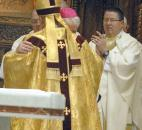 At the end of the Installation Mass, Bishop John D'Arcy was hugged by the newly installed Bishop Kevin C. Rhoades in January 2010 at the Cathedral of Immaculate Conception. Photo by Ellie Bogue