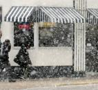 Powers Hamburger Shop customers hustle through snow and wind Feb. 19 to get to the eatery, 1402 S. Harrison St. (Photo by Ellie Bogue of The News-Sentinel))