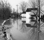 Water from the St. Marys River flows over sandbags at the corner of Camp Allen Drive and Elm Street in Fort Wayne's Nebraska neighborhood.