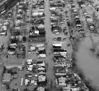 An aerial view shows the St. Marys River overflowing Camp Allen Drive in the West Main Street area on March 14. West Main Street runs vertically through the photo, heading downtown at the top.